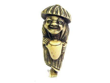 Netsuke en ivoire représentant la légende du voleur d'huile avec tada mori